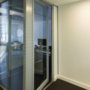 Glazed acoustic doors integrated with office partition